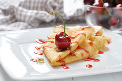 Pancake with cherry. Sweet pancake with cherry sauce and cherries stock photography