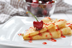 Pancake with cherry Stock Photos