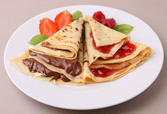 Pancake with chocolate and fruit Stock Photos