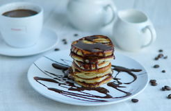 Pancake with chocolate glaze. On a white plate. Selective focus Royalty Free Stock Photo