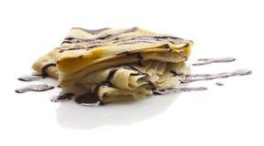 Pancake with chocolate. Sweet pancake with chocolate on white Royalty Free Stock Image