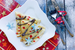 Pancake Christmas tree funny breakfast or dessert. Idea Stock Photo