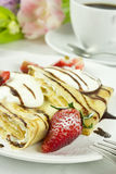 Pancake with coffee and tulip flowers Royalty Free Stock Image