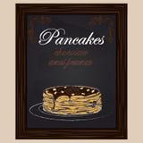Pancake con cioccolato e l'arachide sul piatto Immagine Stock