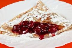 Pancake con le ciliege Fotografia Stock