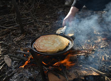 Pancake cooking on fire Stock Images