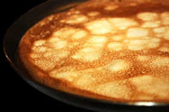 Pancake cooking in a pan Stock Image