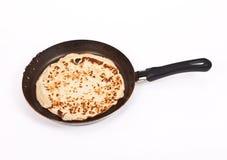 Pancake cooking in a pan Stock Image
