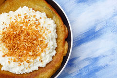 Pancake with cottage cheese and grated coconut topping Royalty Free Stock Photography