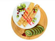 Pancake with cranberry and kiwi II Stock Photos