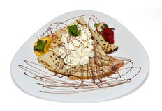 Pancake with cream. Crepe with ice cream and chocolate topping Royalty Free Stock Photos