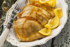 Pancake Crepe Suzette with orange sauce. And liqueur Stock Photos