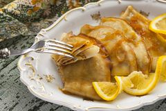 Pancake Crepe Suzette with orange sauce. And liqueur Royalty Free Stock Image