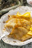 Pancake Crepe Suzette with orange sauce. And liqueur Stock Image