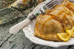 Pancake Crepe Suzette with orange sauce Stock Images