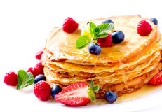Pancake. Crepes With Berries. Pancakes stack over white Royalty Free Stock Photo