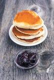 Pancake with currant jam. Stock Photos