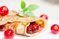 Pancake with currants Stock Image