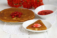 Pancake with currants. Sweet pancakes with jam and red currant.nShallow DOF royalty free stock photography