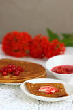 Pancake with currants. Sweet pancakes with jam and red currant.nShallow DOF stock image