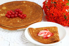 Pancake with currants. Sweet pancakes with jam and red currant.nShallow DOF royalty free stock image