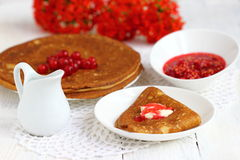 Pancake with currants. Sweet pancakes with jam and red currant.nShallow DOF stock photos