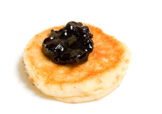 Pancake decorated by jam Royalty Free Stock Photography