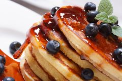 Pancake delicious with blueberries, mint and syrup macro Stock Images