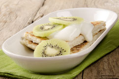 Pancake with double cream and kiwi Royalty Free Stock Images