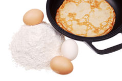 Pancake on a dripping pan, flour, and eggs Stock Images
