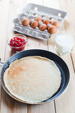 Pancake with eggs and jam on breakfast Royalty Free Stock Photo