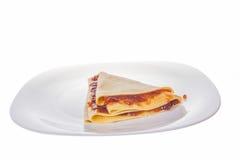 Pancake with eglantine jam. On the plate Stock Image