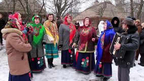 Pancake festival. Ukrainian folk song. KIEV, UKRAINE, MARCH 6, 2011: Pancake festival. Woman in Ukrainian traditional costumes sing Ukrainian folk song. Pancake stock video footage