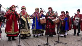 Pancake festival. Ukrainian folk song. KIEV, UKRAINE, MARCH 6, 2011: Pancake festival. Woman in Ukrainian traditional costumes sing Ukrainian folk song. Pancake stock video