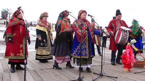 Pancake festival. Ukrainian folk song. KIEV, UKRAINE, MARCH 6, 2011: Pancake festival. Woman in Ukrainian traditional costumes sing Ukrainian folk song. Pancake stock footage