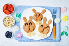 Pancake in the form of a rabbit and dried apricots cashew carrot Royalty Free Stock Image