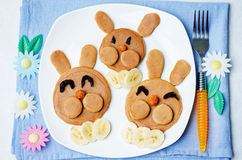 Pancake in the form of a rabbit and dried apricots cashew carrot Stock Photo