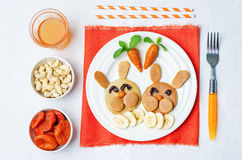 Pancake in the form of a rabbit and dried apricots cashew carrot Royalty Free Stock Photo
