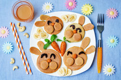 Pancake in the form of a rabbit and dried apricots cashew carrot Royalty Free Stock Images