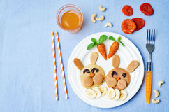 Pancake in the form of a rabbit and dried apricots cashew carrot Stock Images
