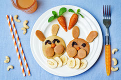 Pancake in the form of a rabbit and dried apricots cashew carrot Royalty Free Stock Photography