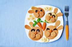 Pancake in the form of a rabbit and dried apricots cashew carrot Stock Photos
