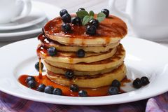 Pancake with fresh blueberries, mint and maple syrup Royalty Free Stock Photo