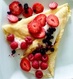 Pancake with fruit. Pancake with cream cheese and fruit Stock Images