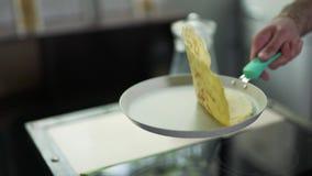 Pancake in a frying pan stock video