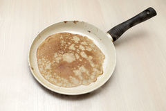 Pancake in a frying pan Stock Photography