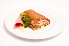 Pancake with ham and cheese. Over white stock photography