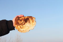 Pancake in a hand Stock Images