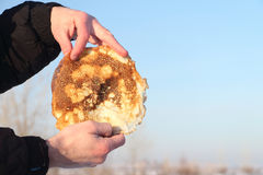 Pancake in hands Royalty Free Stock Photography
