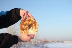 Pancake in hands Royalty Free Stock Photos